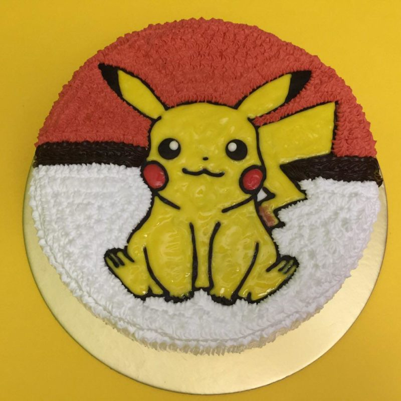 Pikachu Sitting on Pokeball